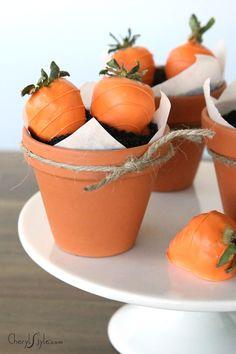 so cute. orange dipped strawberries in dirt cake