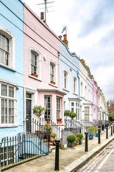 A row of pretty pastel houses on Bywater Street in Chelsea, London. This is one of the prettiest streets in London and is great to explore on a walk.  #london #chelsea #house #pastels