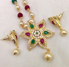 CZ and ruby & emerald pendant with multicoloured chain and earrings Code : PS 393 Price: Rps. 1295/- Whatsap to 09581193795 for order processing
