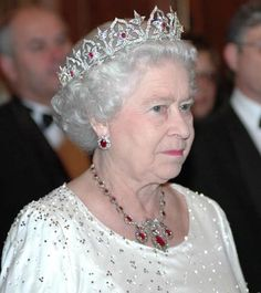 Queen Elizabeth II wearing the Oriental Circlet Tiara, United Kingdom (1853; designed by Prince Albert; made by Garrards; rubies, diamonds). Originally set with opals.