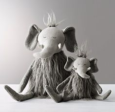 Wooly Plush Elephant- A fine furry friend, designed with playful details every child will love, from the floppy legs and arms to the embroidered accents and lots of fun, different textures. Crafted of special combination of textured fabrics and faux fur. Detailed with embroidered accents