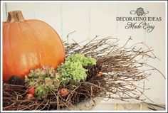 Halloween Yard Decoration - Pumpkin inside wreath on end table between two chairs on front porch