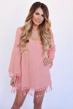 Love the color of the dress with cowgirl boots!!