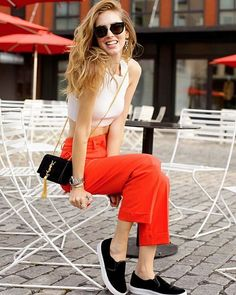A White Crop Top, Orange Trousers, Black Slip-Ons, and a Crossbody Bag