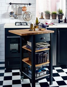 IKEA wooden kitchen trolley with drop-leaf extension being used as a worktop.