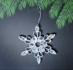 Style 1.  Paper Quilled Snowflake by CathySchlim on Etsy, $6.00
