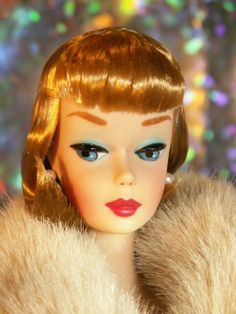 Originally a reproduction Solo In The Spotlight Barbie with pale Caucasian skin tone, this One Of A Kind recreation of the pageboy hair style worn by the 1965 Barbie With Lifelike Bendable legs was designed by MiKelman, along with new\ airbrushed brows & lips.
