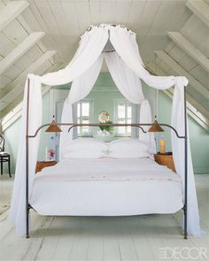 A Bahamas Bedroom: Painted in pastel green, the room is kept shady and cool by louvered shutters.