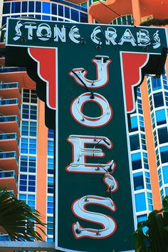 Joes stone crab iconic sign on south beach Miami...ate dinner here on my first visit to South Beach many, many years ago.  It used to be much more formal with a long wait...now in a larger space and very touristy.  Same delicious food!!!!!  :)