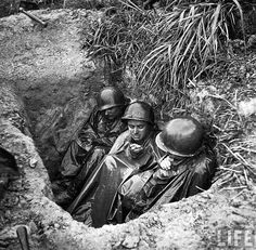 US Marines squeezed in trench, Okinawa 1945