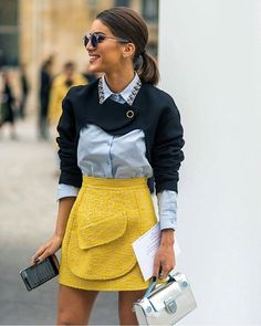 geometric dressing for spring - bright yellow pencil skirt with pocket details, blue button up blouse with collar embroidery, low ponytail, and a white clutch