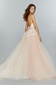 blush pink wedding dress features beautiful lace bodice and tulle skirt