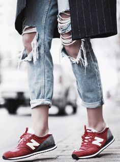 sneakers and destroyed jeans