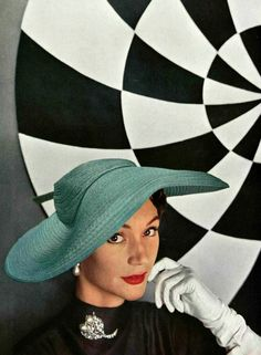 Sophie Malgat in sea-green wide-brimmed hat in wavy fabric by Legroux, diamond and pearl brooch by Roger Scémama, photo by Pottier, 1953