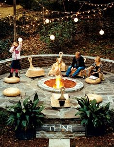 Love the twinkle lights, stone and circular shapes. Fire pit is cool-below ground. Never seen before.