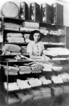 Stella Comino at the counter of Comino and Co. Drapery Shop, Caloundra, ca 1946 / Picture Sunshine Coast, Sunshine Coast Council   thefashionarchives.org