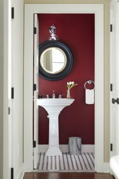 A deep, bold shade can make a small bathroom feel rich, luminous, and cozy all at once. Marsala it-color 2015 Marsala, Bathroom Red, Bathroom Wall, Maroon Bathroom, Burgundy Bathroom, Red Bathrooms, Small Half Bathrooms, Small Half Baths, Small Rooms