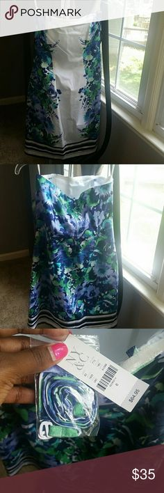 Spring Floral Dress Brand new. Just too short for me since I've gained some weight. Great for summer and spring. Nice dress for weddings and formals to attend. Come with straps that can be attached. Originally listed at $40. New York & Company Dresses Strapless