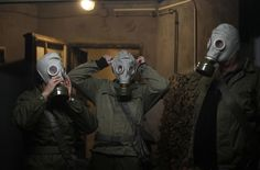 Members of the Hoppmann family wear gas masks during the 'reality event' at the 'Bunker-Museum' in Rennsteighoehe, Germany. (REUTERS/Ina Fas...