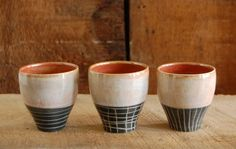 Set of three slip-carved tumblers from Sarah Veak Pottery.