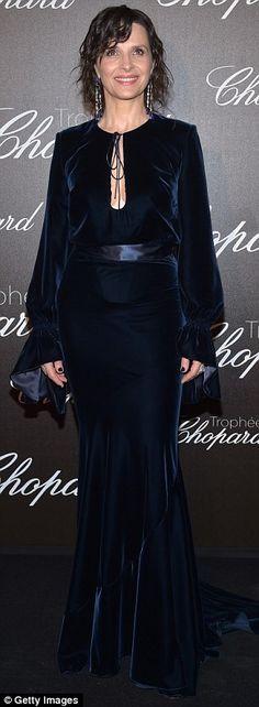 Striking: Juliette Binoche had swapped the Palais des Festivals for theHotel Martinez in her velvet floor-length gown