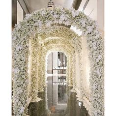 Baby's breath and orchids arches down the hallway wow!