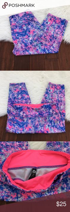 RBX Pink and Blue Paint Splatter Cropped Leggings Brand new without the tags. Never been worn. No flaws. Small hidden pocket in the waistband. Very good quality Leggings. 88% polyester and 12% spandex. RBX Pants Leggings