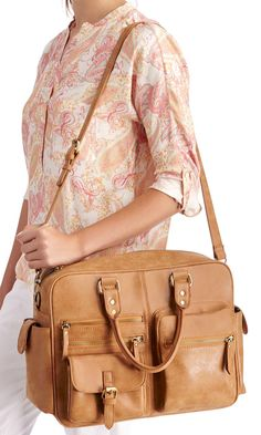 Cognac overnight duffel bag with vintage-inspired charm, lots of pockets and a removable crossbody strap