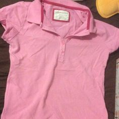 Collared shirt. This is a pink collared shirt from Aeropostale. I've only worn it once. It is a size large and it stretches. Ask me any questions :) Aeropostale Tops