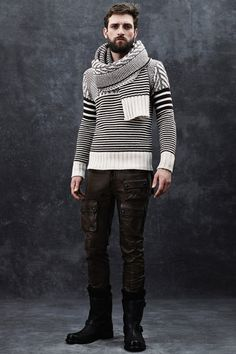 Brown and ecru knit sweater with matching scarf paired with brown leather biker pants by @Belstaff. #IStyleNY #Style