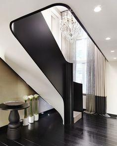 Landing - black and white staircase - dark flooring- beautiful space | Kelly Hoppen Interiors