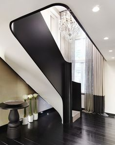 Landing - black and white staircase - dark flooring- beautiful space | Kelly Hoppen Interiors