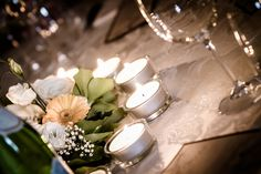 flowers and candles on the table