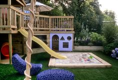 Deck with kids in mind. Design: Boardman, Gelly & Co. Sandbox, sliding board pond, home landscaping, colorful backyard playground, lawn grass, chalk board, entertaining children at home (Grass Top View)