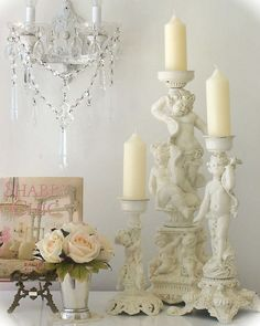 cherub-candlesticks by mylulabelles, via Flickr #Shabby #chic #cherubs  Candlesticks add such warmth and charm to a room.