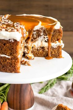 Spiced carrot cake layers infused with maple syrup and topped with maple caramel & cream cheese frosting. | livforcake.com