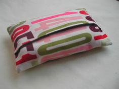 So much better than a plain plastic kleenex pouch in your purse!