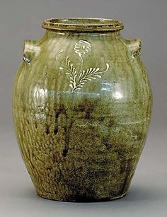 Southern stoneware jar, Rhodes factory circa 1850three to four gallon ovoid form decorated with kaolin sprig flower design on shoulder of both obverse and reverse.