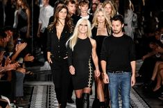 Donatella Versace and designer Anthony Vaccarello on the catwalk in 2014 at the Versus Versace during Mercedes-Benz Fashion Week in New York.