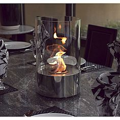 @Overstock - The decorative indoor fireplace is the perfect accent to any table, in any setting. This portable tabletop fireplace features a polished stainless steel base and stunning tempered glass cylinder encasing the flames.http://www.overstock.com/Home-Garden/Accenda-Stainless-Steel-Clear-Portable-Fireplace/6491596/product.html?CID=214117 $169.00