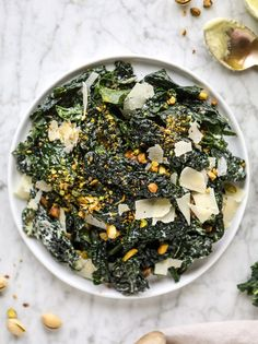 This kale salad is so super delicious, flavorful and easy! The base is lacinato kale but you can certainly use curly green kale. The only important ingredients are roasted pistachios and shaved parmesan cheese! A cream parm dressing made with yogurt takes Healthy Salads, Healthy Eating, Healthy Recipes, Healthy Food, Kale Salads, Vegetable Recipes, Delicious Recipes, Clean Eating, Yummy Food