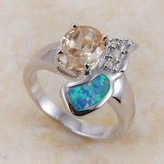 'Blue Fire Opal Morganite (Lab) WGF Ring SZ8' is going up for auction at  2pm Tue, May 14 with a starting bid of $5.