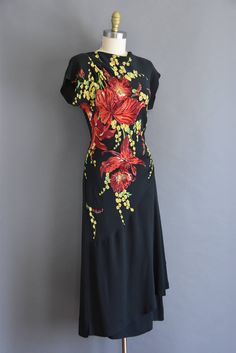 Rare 1940s vintage black rayon crepe dress with a sequin