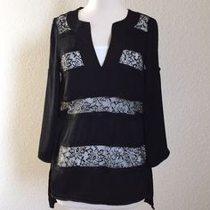 BCBGMaxazria Tunic Top Black BCBGMaxazria v-neck tunic top in XS. Alternating bands of solid black and black lace. Only worn twice. White tank not included or for sale. BCBGMaxAzria Tops Tunics