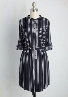 Prepped with pamphlets and looking sophisticated in this collarless shirt dress, you're eager to find the best candidate for your opening. With its white stripes, long tab sleeves, and cinching sash, this frock has you feeling confident that among the applicants aplenty, your ideal intern awaits!