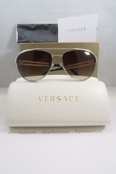 Versace MOD 2165 1000/13 Aviator Silver w/ Black Temple Tips. MODEL#017  New 100% Authentic Sunglasses. Size: 58mm 15mm 140mm. Engraved with an unique serial number from the manufacturer to avoid imitation. Item is shipped with the original Versace Box, Tag, Versace hard cover case, Versace microfiber cleaning cloth & Authenticity Card. Made in Italy.  Price: $2100.00 (Available by Order)