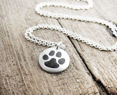 Tiny cat paw print necklace in silver by lulubugjewelry on Etsy, $30.00
