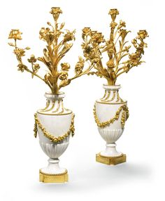 A pair of gilt-bronze-mounted white marble candelabra, now converted to lamps, in Louis XVI style | Lot | Sotheby's
