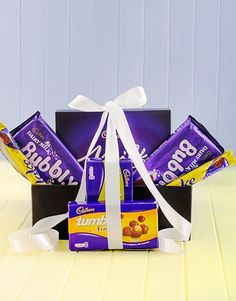 NetFlorist is South Africa's number one gifting service, offering a wide selection of gifts and floral arrangements. Cadbury Chocolate, Chocolate Gifts, Condolence Flowers, Hampers Online, Floral Arrangements, Candy, Condolences, Gift Ideas, Marketing