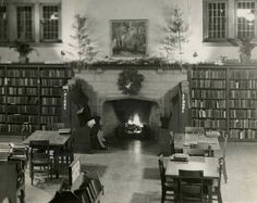A cosy, warm picture for a cold, blustery week: Toronto Public Library staff member Marjorie Bullard reads in the Children's section, ensconced in the inglenook of the High Park library's fireplace. This photograph was taken by her brother, Maurice, at Christmastime in 1940. Marjorie worked in several branches in her 45 years of service, and retired from the Locke branch in 1973.   Creator: Bullard, Maurice, 1899-1967 Date:  1940 Identifier: TPL-A-0160 Format: Picture Rights: Public domain…